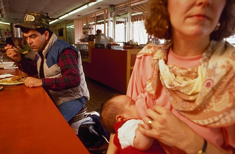Woman Breast Feeding in a Restaurant